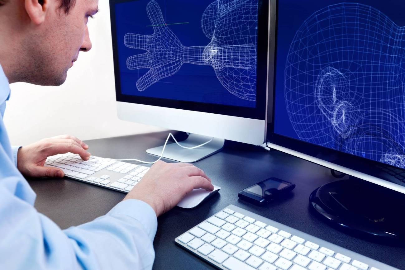 3D animator working on computer model