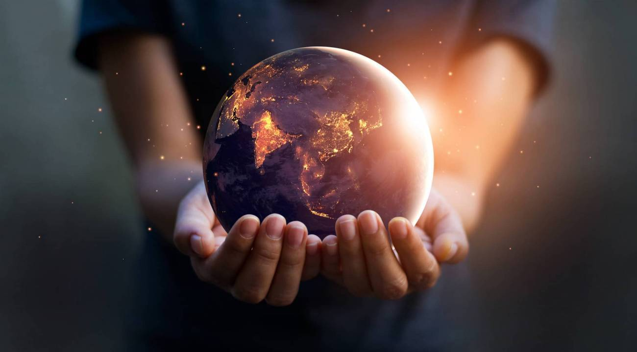 A person holding the earth in their hands.