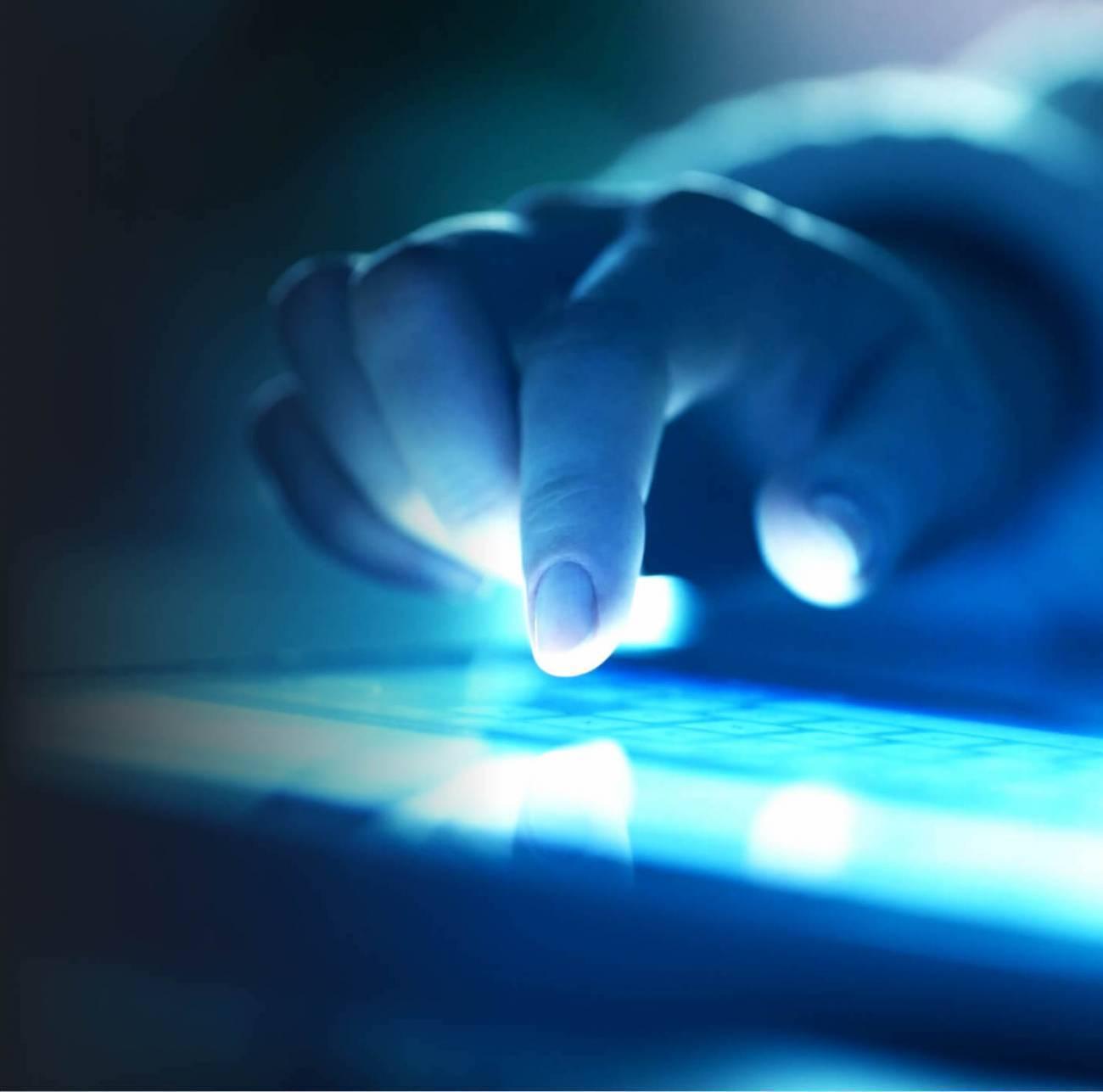 A finger touching a digital screen.