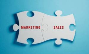 puzzle pieces labeled marketing and sales connecting
